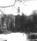 Chapel in woods with snow