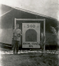 540th Amph Tract Bn man at Sign